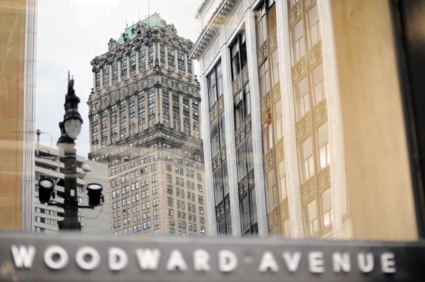 The abandon Neoclassical Book Tower built in 1926 is reflected in a building's glass on the Historic Woodward Avenue