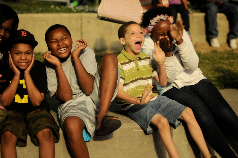 Jordan Love, Jaylon Wilburn, Tyler Everson, and Kayla Love of Detroit scream at the loud sounds of the final of the Detroit fireworks in Hart Plaza, June 23. (Tanya Moutzalias/Special to the Detroit News)