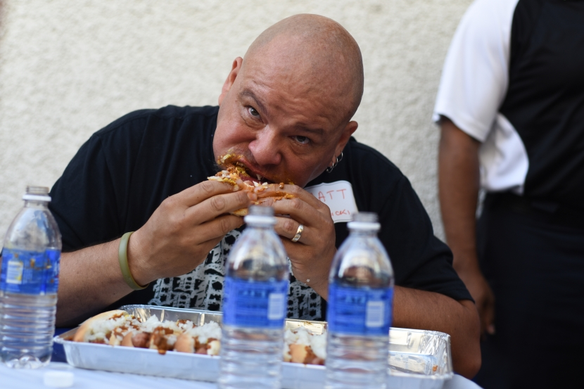 Matthew Holowicki, of Plymouth, destroys coney dog after coney dog at the 4th annual American Coney Island Coney Dog Eating contest Thursday in downtown Detroit, Aug. 28. Holowicki would win the eating challenge by breaking a record by consuming 17 coney dogs. (Tanya Moutzalias/ Special to the Detroit News)