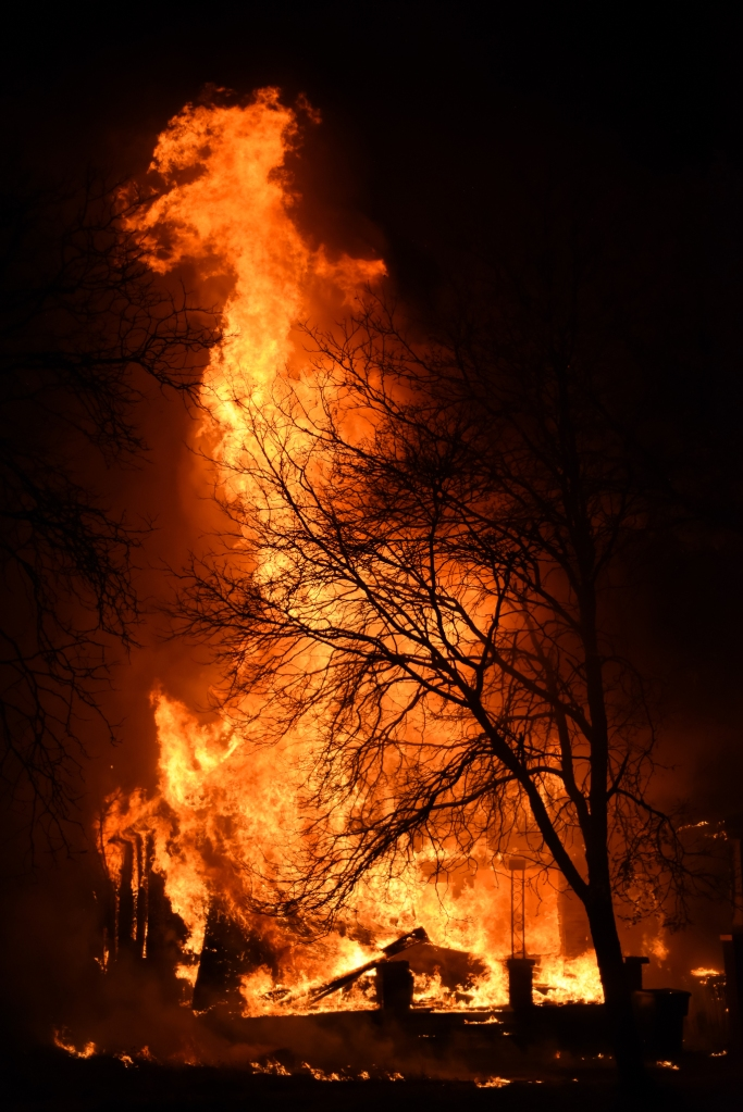 Flames shoot high into the air as Detroit Firefighters took a defensive stance at an abandon dwelling fire at 3140 E. Kirby St., between Elmwood and McDougall St. on Detroit's near east side, just after midnight on Devil's Night Oct. 31, 2014. The fire spread to the abandon house next door as DFD tried to stop it from spreading further to an occupied dwelling beside that. At the same time less than a mile away DFD fought two vacant dwelling fires.