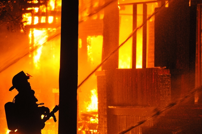 Detroit Firefighters use fire 3 hoses to fight two fully-engulfed abandon dwelling fires at 3140 E. Kirby St. between Elmwood and McDougall St. on Detroit's near east side just after midnight on Devil's Night Oct. 31, 2014.