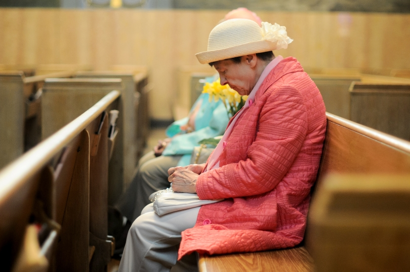 Theresa Trybus, of Detroit, fiddles with rosary beads during the Easter Sunday service at Ss. Peter and Paul Orthodox Cathedral, 3810 Gilbert St., in Detroit on Sunday April 20, 2014. (Tanya Moutzalias/Special to the Detroit News)