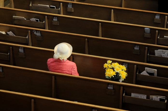 Theresa Trybus, of Detroit, sits next to spring flowers during the Easter Sunday service at Ss. Peter and Paul Orthodox Cathedral, 3810 Gilbert St., in Detroit on Sunday April 20, 2014. (Tanya Moutzalias/Special to the Detroit News)