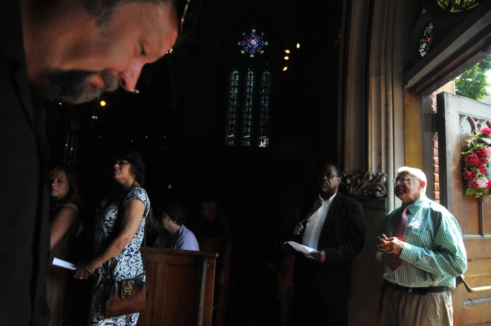 Church-goers stand in the aisles of the packed St. Albertus Church, Detroit's oldest Polish Church dating back to 1872. Detroit Mass Mob brought Church-goers from all over Metro Detroit, who filled the pews, aisles and spilled outside the doors at St. Albertus Church on Sunday Aug. 10 (Tanya Moutzalias/ Special to the Detroit News)