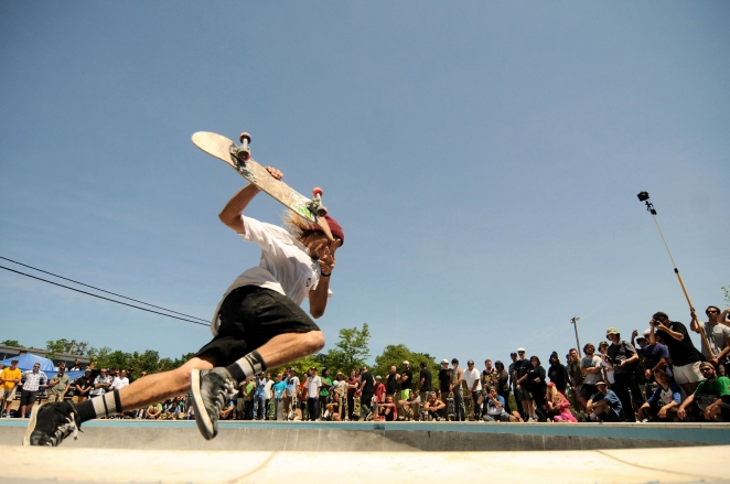 SA - Mark Davenport, 26 of Toledo, skates the big bowl in the advance contest at the grand opening of the Ann Arbor Skatepark in Veterans Memorial Park in Ann Arbor, MI on Saturday, June 21, 2014.