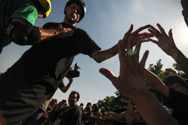 SF - Legendary skateboarder Tony Hawk high fives kids as his walks along the edge of the 'big bowl' at the new Ann Arbor Skatepark in Veterans Memorial Park during its grand opening on Saturday in Ann Arbor, MI, June 21, 2014.