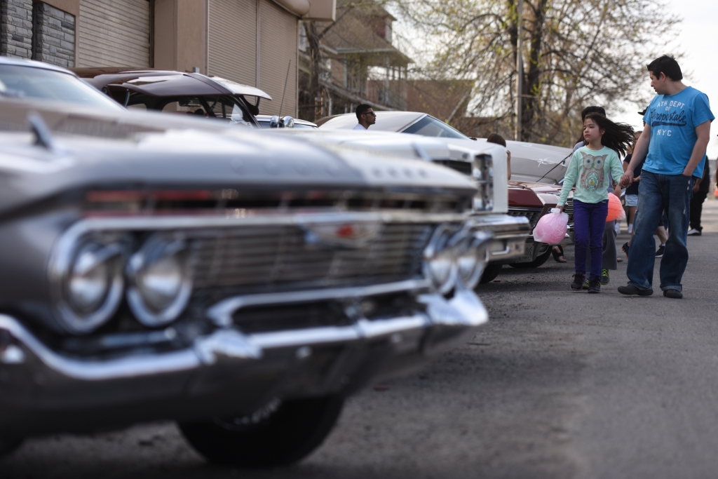 Yedani, 7, and Pablo Mata, of Detroit, look at the car along Livernois Ave during the 17th annual Blessing of the Lowriders in Southwest Detroit. The event gathers custom car owners to bless their rides before the start of cruising season on Sunday May 3, 2015. (Tanya Moutzalias | MLive Detroit)