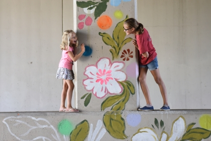(left) Olivia, 6, and her sister Sophia Nowaczewski, 11 of St. Clair Shores, play around a mural in the Dequindre Cut. The Detroit Design Festival kicked off this week bringing crowds to the Dequindre Cut to see the interaction art installations along the greenway, Sept. 26, 2015. SaturdayÕs youth day brought people of people of all ages to see the 5 installations set out across the 1.35-mile greenway in DetroitÕs Lafayette Park. (Tanya Moutzalias | MLive Detroit)