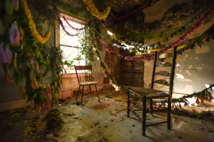 A floral art installation covers the worn walls, floors and ceiling of a vacant home in Hamtramck on the border of Detroit Saturday, Oct. 17. 2015. The vacant house was bought for $250 in an foreclosure auction to be used for the art installation, Flower House, created by Pot & Box florist Lisa Waud. Over 2,000 visitors are expected to view the sold-out installation this weekend before the flowers are composted, the house dismantled and a flower farm built in its place. (Tanya Moutzalias | MLive Detroit)