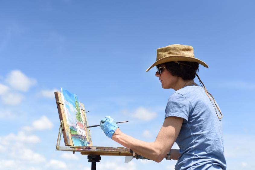 Catherine Elsey, of Grosse Pointe, paints the historic 1902-built Detroit Boathouse on Belle Isle, June 3, 2015. (Tanya Moutzalias   MLive Detroit)