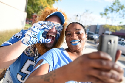 """Edwin """"Grizz"""" Griswold poses for a photo with Alicia Littles, of Detroit, in Detroit's Eastern Market ahead of the Detroit Lions home opener against the Denver Broncos at Ford Field Sunday evening, Sept. 27, 2015. (Tanya Moutzalias 