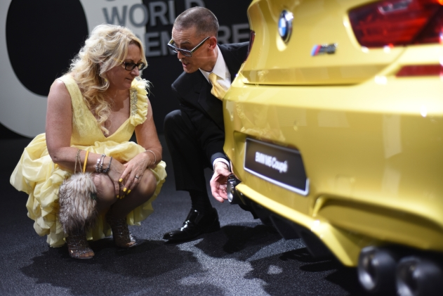 Tracy and Robert Clark, of Rochester, take a closer look at the muffler on a BMW M6 Coupe at the Detroit auto show's Charity Preview Friday night Jan. 16, 2015. (Tanya Moutzalias | MLive Detroit)
