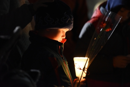 Asher Luton, 7, a classmate of Emma Watson Nowling's holds a candle during the vigil with family, friends and several hundred community members at Taylor Sportsplex Thursday evening, Dec. 10, 2015. Nowling was killed at the Taylor Sportsplex, Dec. 3. Her mother, 37-year-old Sharon Elizabeth Watson, was also shot and is in serious but stable condition at an area hospital. The were shot leaving Nowling's soccer practice by a family-friend before turning the gun on himself. (Tanya Moutzalias | MLive Detroit)