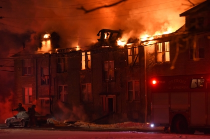 Detroit Fire Department crews battled a 2nd alarm fire at a occupied 2 story 30-unit apartment building at 11210 E Canfield near French Rd. on Detroit's east side. The fire broke out just before 11 p.m Monday night as temperatures dropped to 3 degrees, Feb. 23, 2015. No injuries were reported at this time. (Tanya Moutzalias | MLive.com)