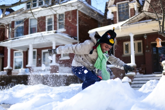 Corey Allen, 10 of Detroit, plays in the snow in Detroit's Historic Woodbridge Neighborhood Monday morning, Jan. 2, 2015. Allen and his brother are originally from South Carolina and have never seen this much snow in their lifetime. The historic snowfall brought 16 inches to the Metro Detroit region. (Tanya Moutzalias | MLive Detroit)