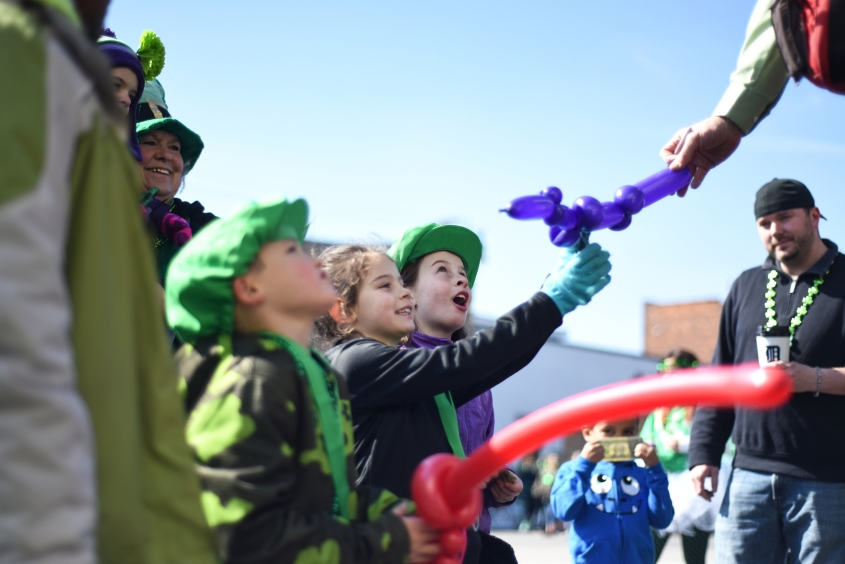 (right) Sophia Harman, 8, May Harman, 7, and Dillan Laible, 6, watch their balloon animals being made. on Michigan Ave. before the parade. Thousands attended the 2015 St. Patrick's Parade in Detroit's historic Irish Corktown neighborhood on a sunny Sunday afternoon March 15, 2015. (Tanya Moutzalias | MLive Detroit)