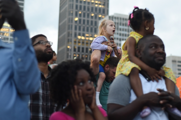 Olivia Cassat, 5, watches the fireworks from her father's shoulders. Thousands enjoyed the 2015 Ford Fireworks from Hart Plaza Monday night, June 22, 2015. The annual firework show was moved up an hour due to threat of severe thunderstorms. (Tanya Moutzalias | MLive Detroit)