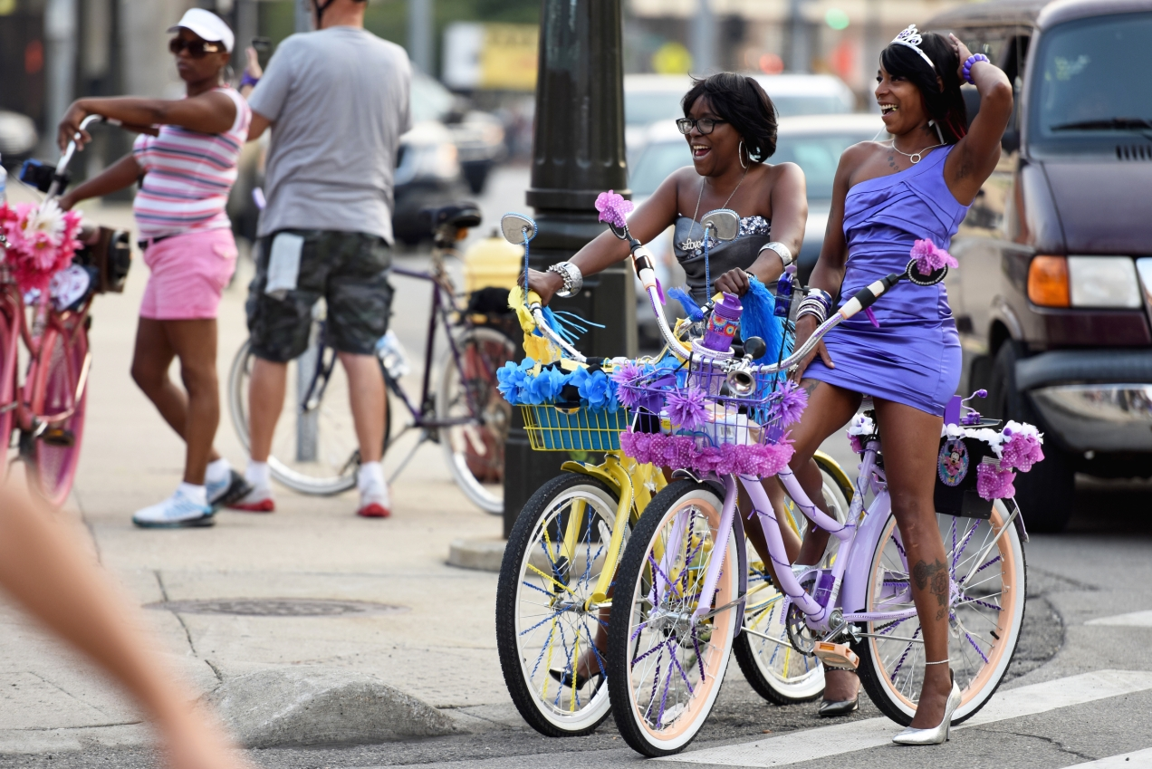 """Somewhere between 3,000 and 5,000 bicyclists rode through the streets of Downtown Detroit for the weekly Slow Roll ride on Monday Aug. 31, 2015. This Monday's ride was unique from the other rides, in that it was Slow Roll """"prom"""" where riders are asked to dress up for the occasion. The roll is shorter than usual, at 5 miles bicyclists save their energy to dance the night away at St. Andrews Hall in Detroit's Greektown. (Tanya Moutzalias 