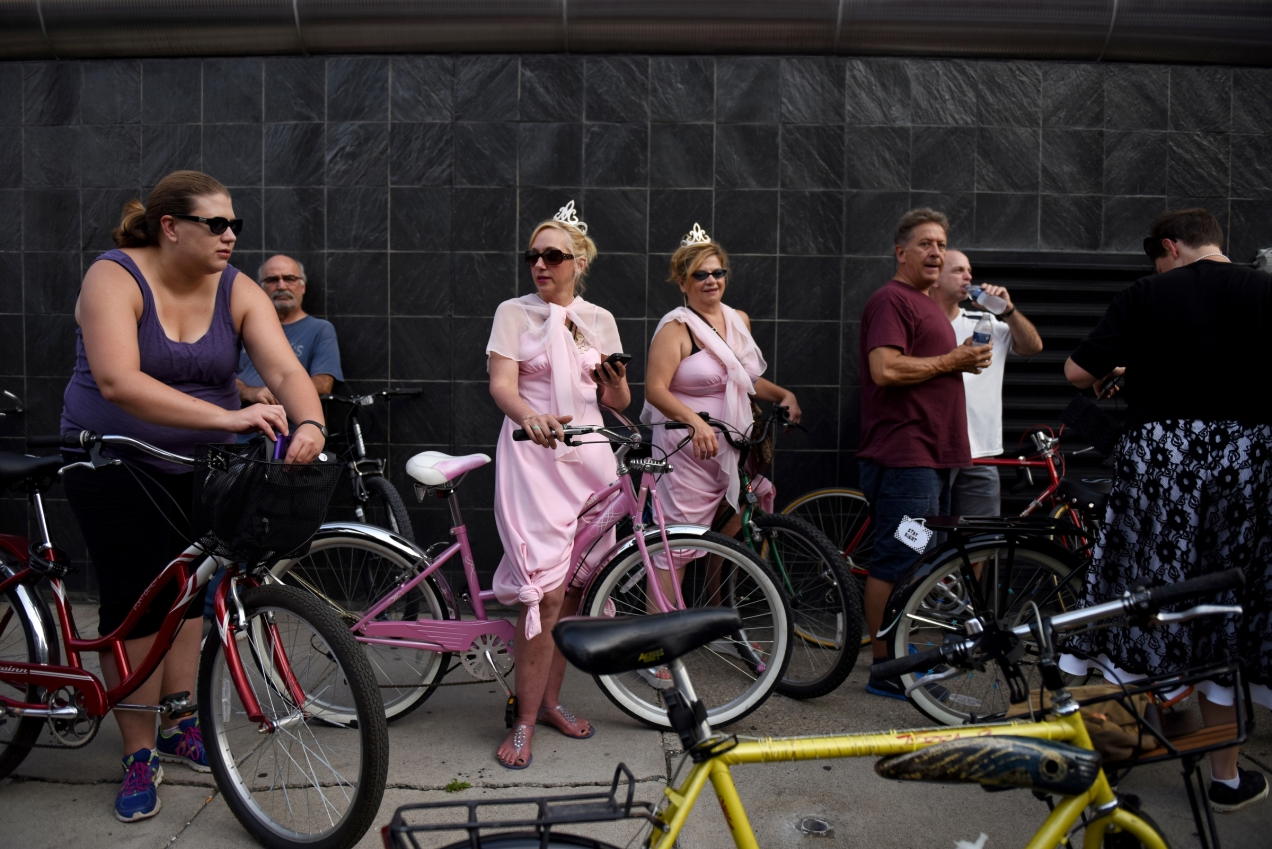 "Somewhere between 3,000 and 5,000 bicyclists rode through the streets of Downtown Detroit for the weekly Slow Roll ride on Monday Aug. 31, 2015. This Monday's ride was unique from the other rides, in that it was Slow Roll ""prom"" where riders are asked to dress up for the occasion. The roll is shorter than usual, at 5 miles bicyclists save their energy to dance the night away at St. Andrews Hall in Detroit's Greektown. (Tanya Moutzalias 