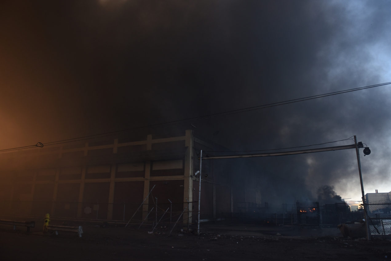 Heavy smoke billows from a warehouse Wednesday morning, Feb. 2, 2016. A multiple alarm fire broke out in a massive warehouse at Hamilton Ave. and Manchester Pwky in Highland Park, Mich. just after 2:30 a.m. Wednesday. Officials said the fire could potentially continue burning for days. (Tanya Moutzalias | MLive Detroit)