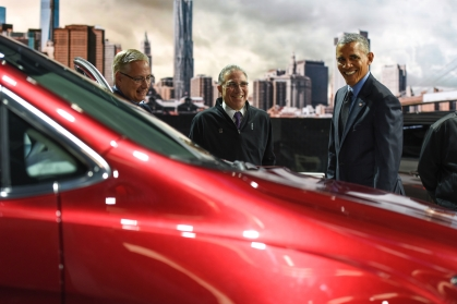"""President Barack Obama takes a look at the new 2017 Chrysler Pacifica alongside (left) Mitch Clauw, Fiat Chrysler's vice president of vehicle of engineering, and Paul Sabatini, NAIAS Chairman while touring the 2016 North American International Auto Show at Cobo Center in Detroit Wednesday, Jan. 20, 2016. """"Beautiful. You guys remember 'Get Shorty,' right? It's cool driving a minnivan,"""" said the President. (Tanya Moutzalias 