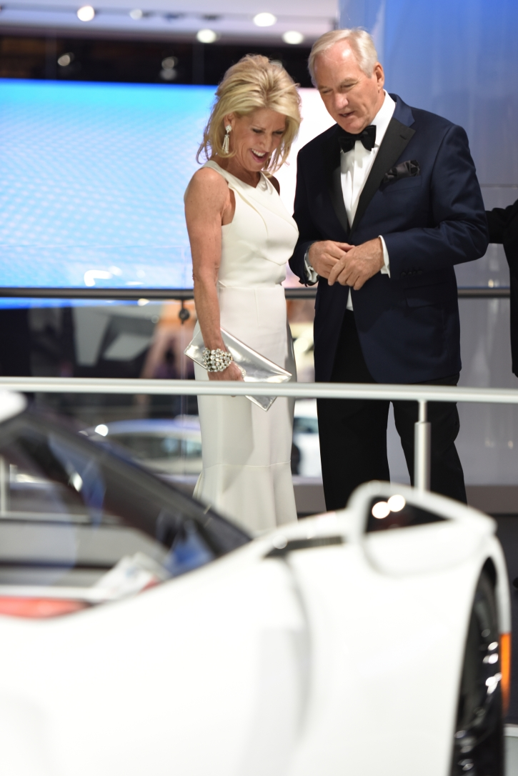 Fair Radom, of Bloomfield Hills, and Bruce Milones, check out the white Ford GT at the auto show's Charity Preview Friday evening, Jan. 15, 2016. Over 13,000Êattended the 2016 North American International Auto Show's 40th annual Charity Preview at Cobo Center in Detroit. Attendees, dressed in their very best for the black-tie event known as 'Auto Show Prom,' mingled on the showroom floor getting a look at the more than 750 vehicles before Saturday's public opening. (Tanya Moutzalias | MLive Detroit)