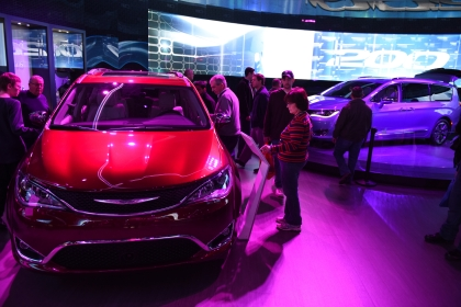 Auto show attendees take a closer look at the 2017 Chrysler Pacifica. Thousands of visitors attended the 2016 North American International Auto Show for Ôfamily dayÕ on Friday at Cobo Center in Detroit, Jan. 22, 2016. (Tanya Moutzalias | MLive Detroit)