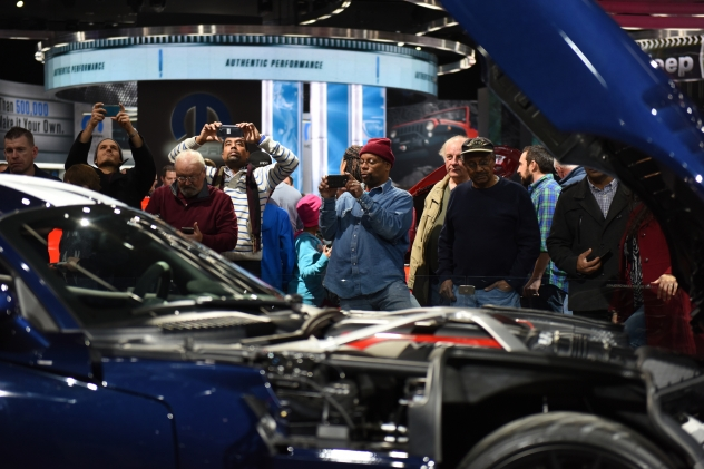 Auto show attendees take photos of the Dodge Viper ACR. Thousands of visitors attend the 2016 North American International Auto Show for Ôfamily dayÕ on Friday at Cobo Center in Detroit, Jan. 22, 2016. (Tanya Moutzalias | MLive Detroit)