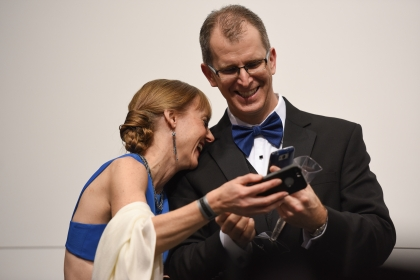 Alison and Tom Bazil, of Bloomfield Hills, laugh over photo they took at the BMW display at the auto show's Charity Preview Friday evening, Jan. 15, 2016. Over 13,000Êattended the 2016 North American International Auto Show's 40th annual Charity Preview at Cobo Center in Detroit. Attendees, dressed in their very best for the black-tie event known as 'Auto Show Prom,' mingled on the showroom floor getting a look at the more than 750 vehicles before Saturday's public opening. (Tanya Moutzalias | MLive Detroit)